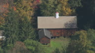 AERIAL Fall foliage surrounding a cottage / Deerfield, Massachusetts, United States