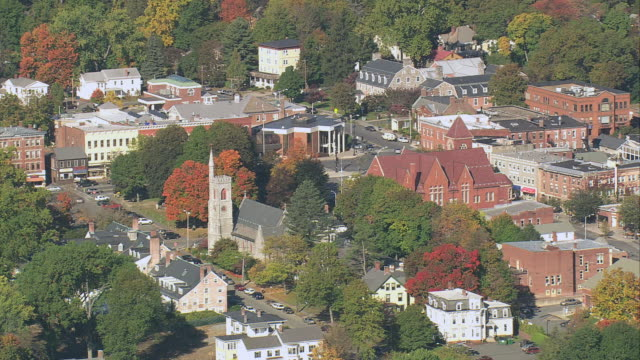 AERIAL Fall foliage surrounding small town / Amherst, Massachusetts, United States
