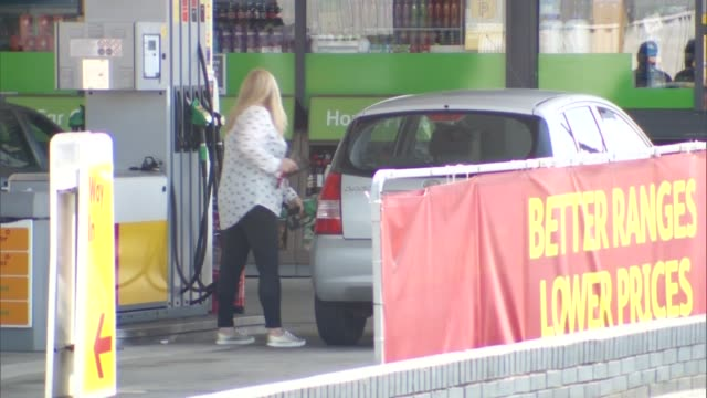 Fall in inflation driven by cheaper petrol and diesel costs Chorley market and [petrol station Various of customers filling up cars at Shell petrol...