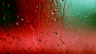 Falling rain on window glass