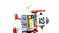 Falling tin toy robots with key