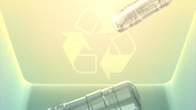 Falling water bottles viewed from inside the recycling bin