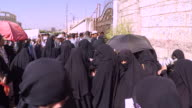 Families in Yemen queueing for food being provided by aid organisations