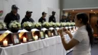 Families of 19 victims of Colombias armed conflict get back their remains in a ceremony in Medellin