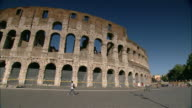 Families visit the ruins of Rome's ancient Colosseum.