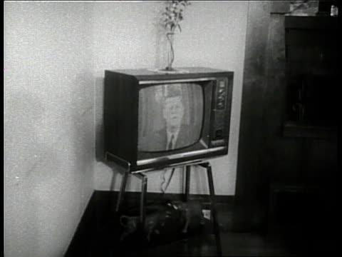 Families watch the televised debate between Senator John F Kennedy and Senator Richard Nixon in 1960