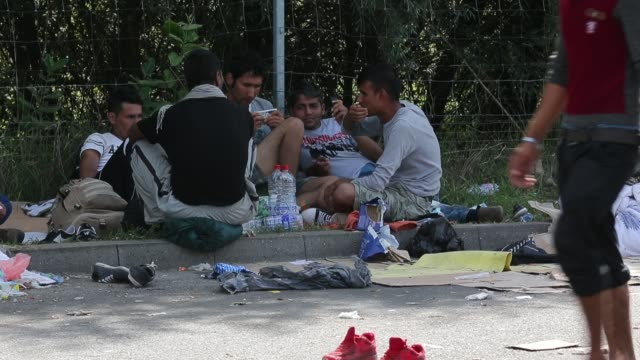 Families who had crossed into Hungary from Serbia camp near a collection point awaiting buses to take them to a refugee camp on September 8 2015 in...