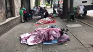 Families with young children sleep on the streets of Mexico City and a restaurant in Roma neighbourhood prepares sandwiches and juice for victims the...