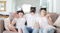 Family at home using VR helmets