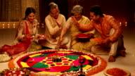 Family celebrating diwali festival, Delhi, India