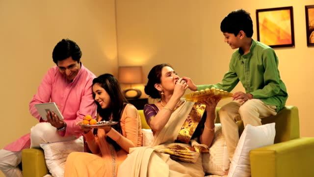 Family celebrating Raksha Bandhan, Delhi, India