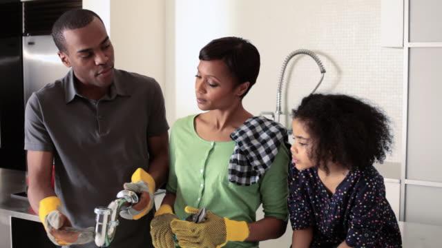 Family doing plumbing