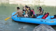 Family doing river rafting