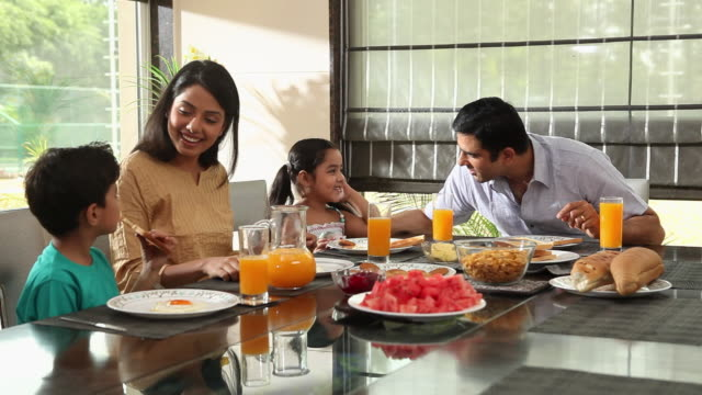 Family eating breakfast in a dining room