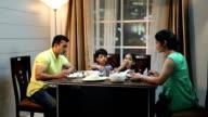 Family eating dinner at home, Delhi, India