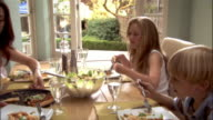Family eating healthy lunch at kitchen table