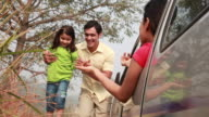 Family enjoying at roadside