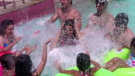 Family enjoying at swimming pool at water park, Delhi, India