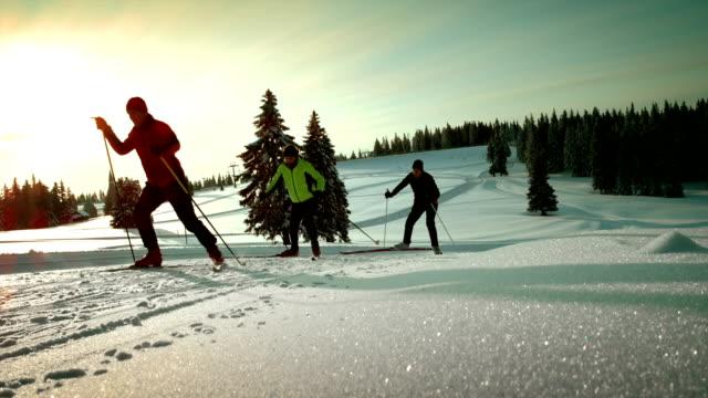 SLO MO family enjoying on a cross country skiing track