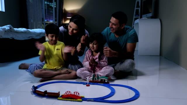 Family enjoying toy set at home, Delhi, India