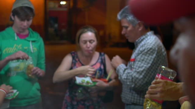 Family enjoys tacos at outdoor taco stand