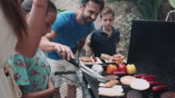 Family having a Barbecue near Pool in Holiday Home