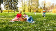 Family having a picnic in park