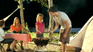 Family Having Barbecue At Campsite