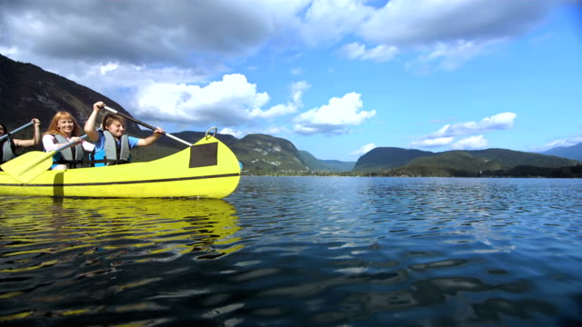 Family Having Fun Canoeing