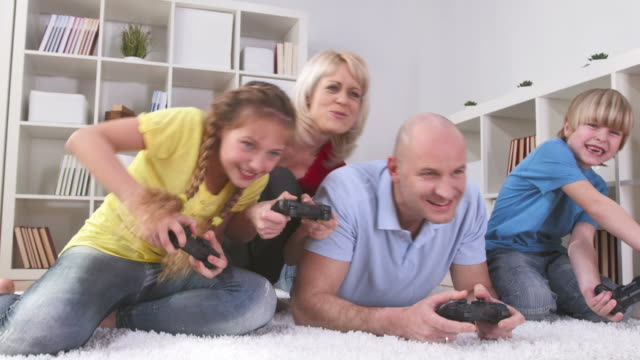 HD DOLLY: Family Having Fun Playing Video Games