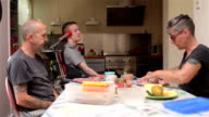 Family having lunch with disabled son