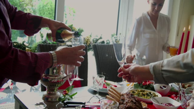 Family Having Traditional Christmas Dinner with Roasted Veal Rack - 4k Video