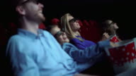 Family in a movie theater.