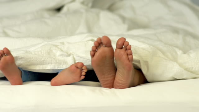 Family in bed and their feet