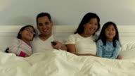 Family in bed together