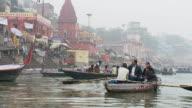 WS SLO MO Family in boat moving in front of Main ghat / Varanasi, Uttar Pradesh, India