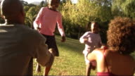 Family in park with skipping rope