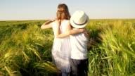 Family in wheat field