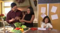 MS DS Family including girl (6-7) preparing salad in kitchen / Heber City, Utah, USA