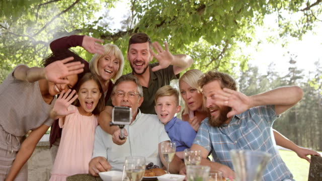 SLO MO Family making a video at the picnic table