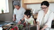Family making together a lunch in kitchen on a holiday