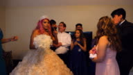 MS Family members gathered in living room of home with young woman dressed in quinceanera gown