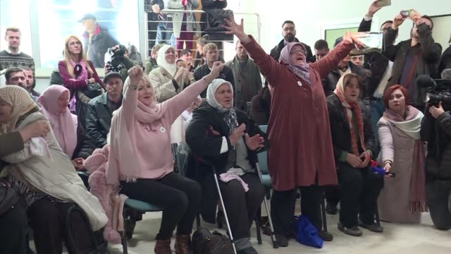 Family members of victims of the Bosnian war's Srebrenica massacre react to the UN court verdict that former Bosnian Serbian commander Ratko Mladic...