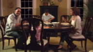 MS, PAN, family of four having dinner at dining room table, Westfield, New Jersey, USA