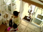 HA,  MS,  family of three entering holiday house,  Harbour Island,  Bahamas