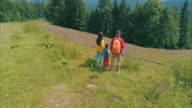 Family of three on a hike in mountains
