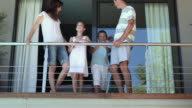 Family on balcony of holiday home