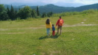 Family on mountain in daytime