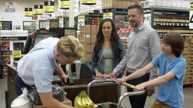 Family paying in a warehouse supermarket