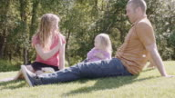 UHD 4K: Family playing and spending time together in a park